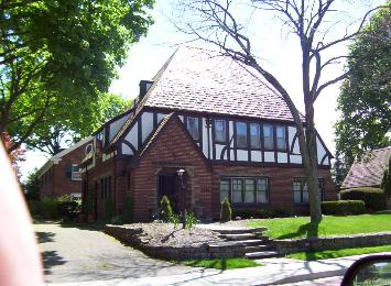 Exterior painting of this tudor stucco home in canton ohio by northcoast painting and pressure washing