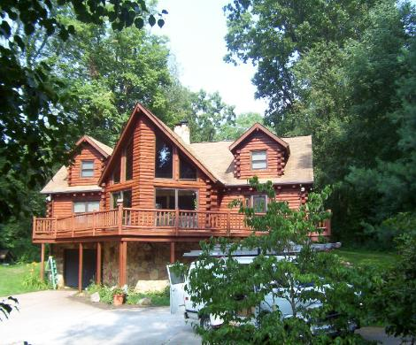 Exterior Staining of a log home in WOOSTER Ohio by NORTHCOAST Painting and Pressure Washing